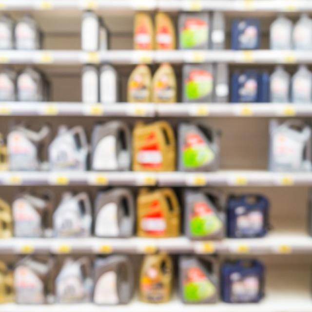"""""""Blurred motor oil on shelves in supermarket"""" stock image"""