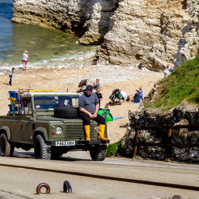 """Fishing Cobbles Catch of Crabs Transported by Landrover to the Top of North Landing"" stock image"