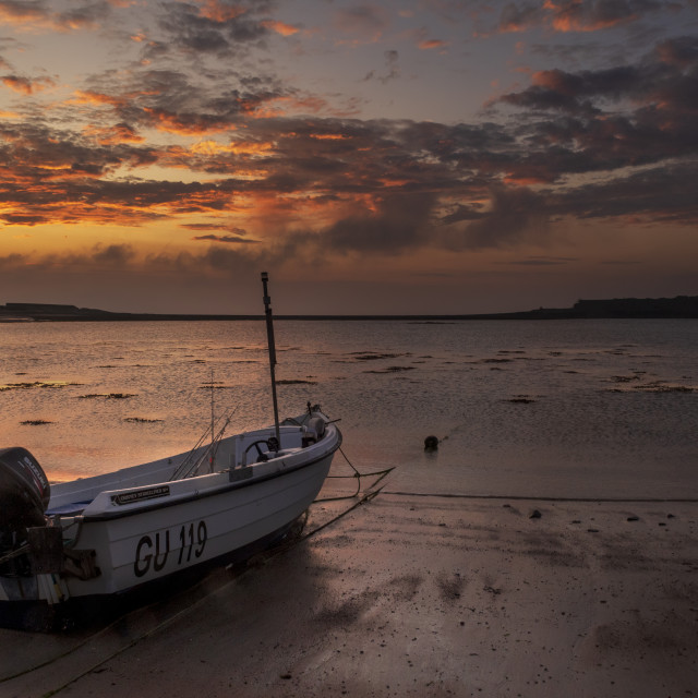 """Dawn Fishing boat at Longis beach, alderney"" stock image"