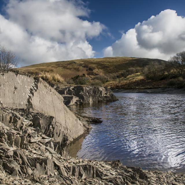 """Llyn Clywedog slate and water"" stock image"