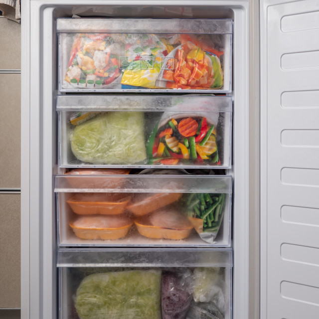 """""""Opened freezer refrigerator with frozen meal"""" stock image"""