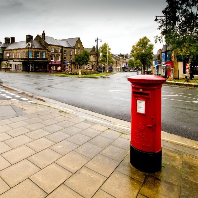"""Pillar, Postbox in the Rain, Ilkley"" stock image"
