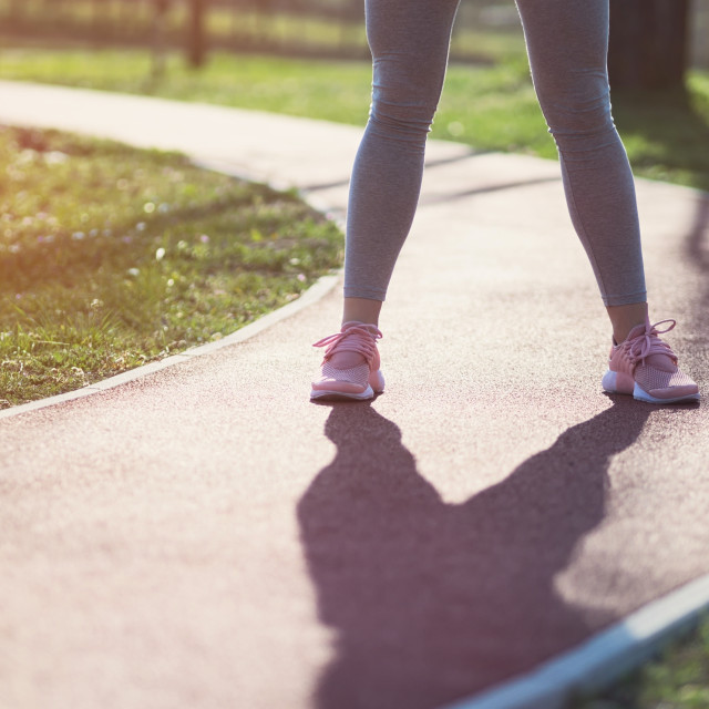 """Woman Standing on Running Track"" stock image"