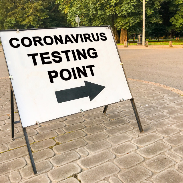 """""""Sign showing the way to a Coronavirus testing center"""" stock image"""