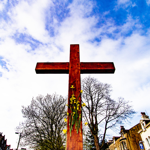 """Easter Cross with Daffodils, top of Brook Street, Ilkley ,Yorkshire, England, UK."" stock image"