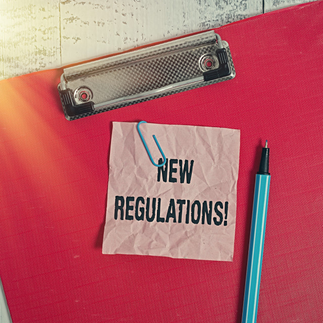 """Conceptual hand writing showing New Regulations. Business photo text rules..."" stock image"