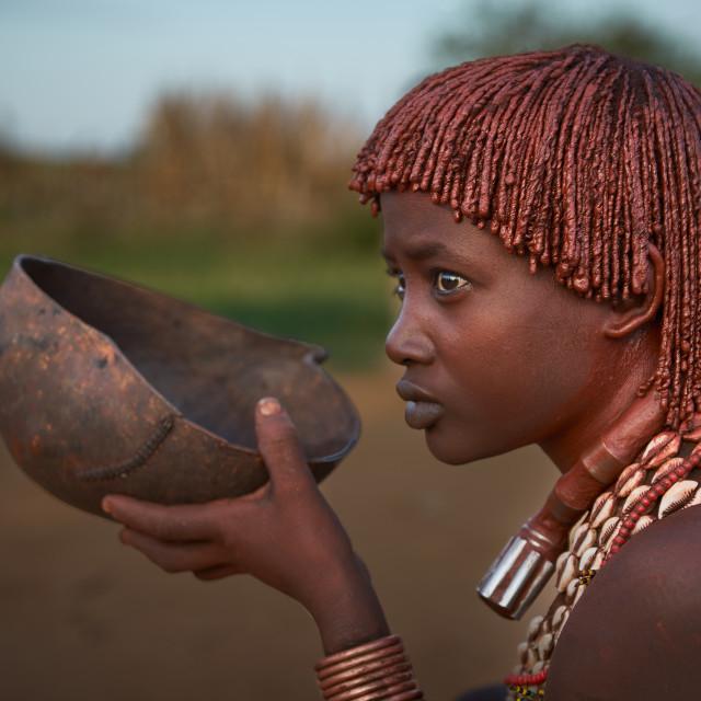 """""""Hamer tribeswoman having her early morning breakfast"""" stock image"""