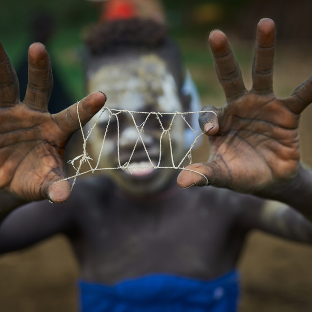 """""""Mursi boy and his string"""" stock image"""
