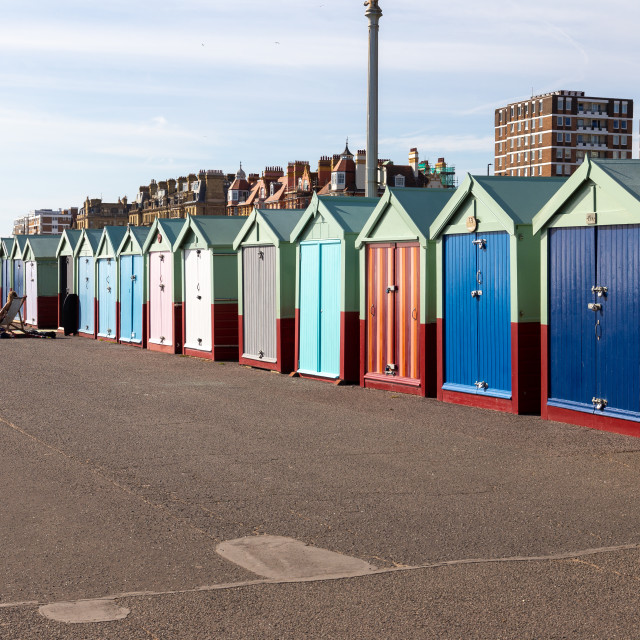 """Colourful beach huts on the Seafront Esplanade, Brighton, UK"" stock image"