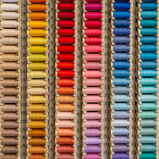 """Multi-coloured sewing cotton reels"" stock image"