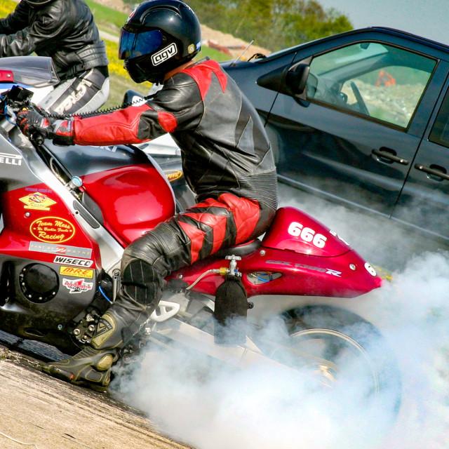 """Elvington Bike Track Day, April 2004, Burning Rubber"" stock image"