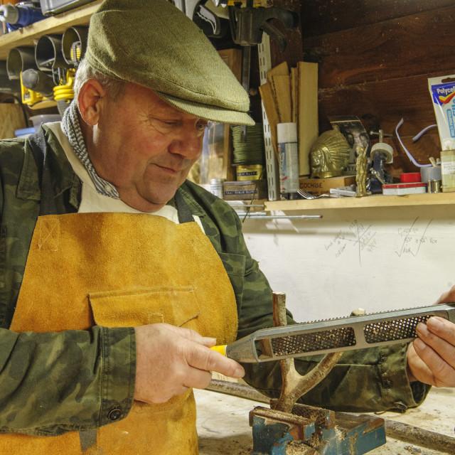 """""""Craftsman making a Walking Stick"""" stock image"""