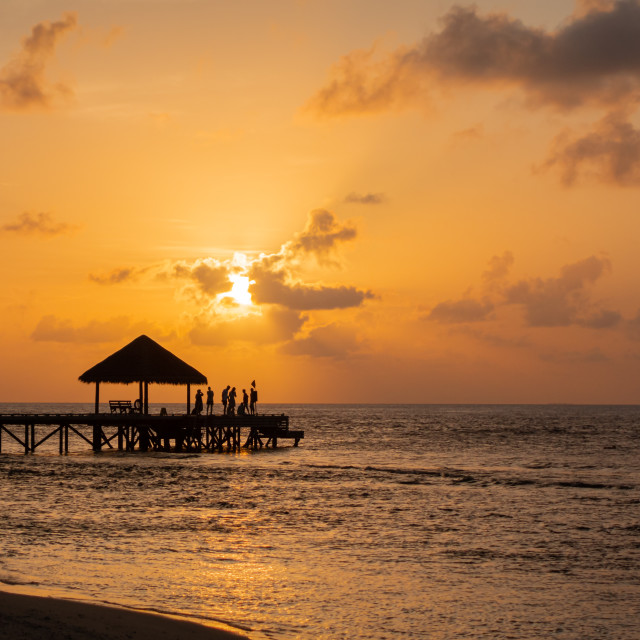 """""""End of Pier, Sunset Party, Maldives"""" stock image"""