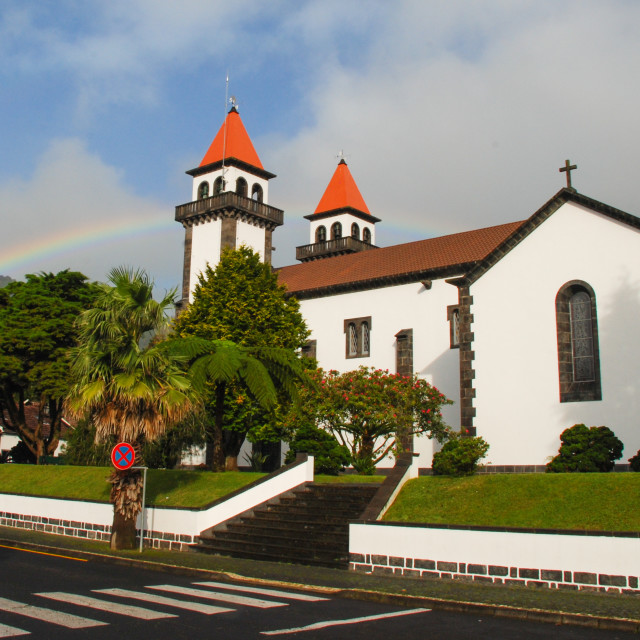 """Rainbow and church at Furnas, Azores"" stock image"