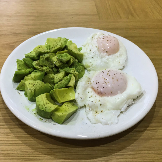 """""""Poached eggs with fresh avocado and black pepper"""" stock image"""