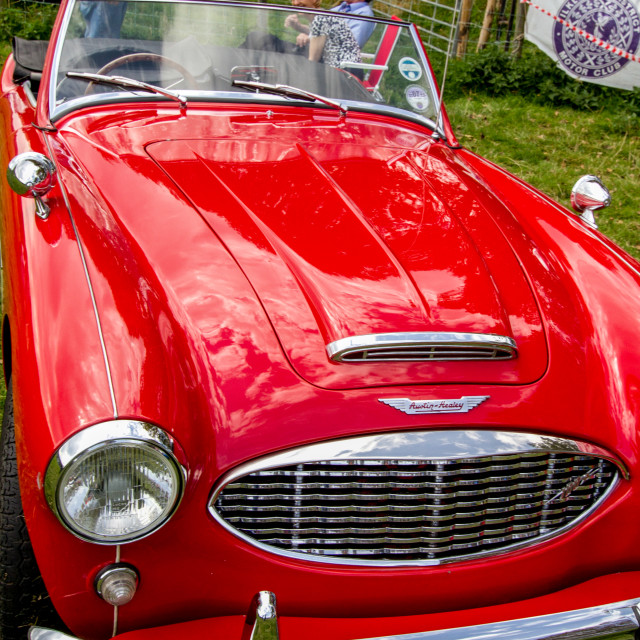 """""""Red Austin Healey 3000 Sports Car on display at Otley 2012 Vintage Transport Extravaganza"""" stock image"""