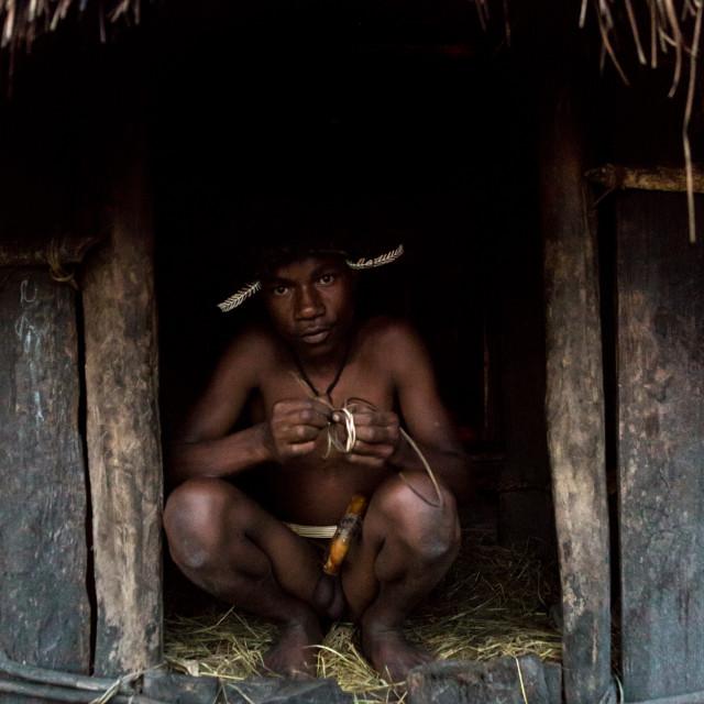 """""""Young Dani boy at the entrance of a honai"""" stock image"""