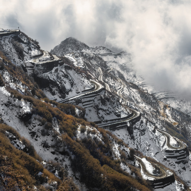 """Famous Zigzag himalayan mountain road of Zuluk, covered with sno"" stock image"