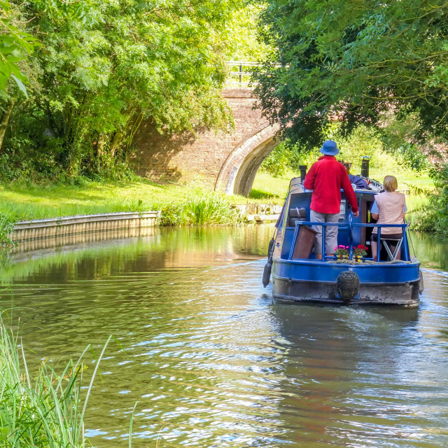 """""""Boating on the Welford Arm of the Grand Union Canal, UK"""" stock image"""