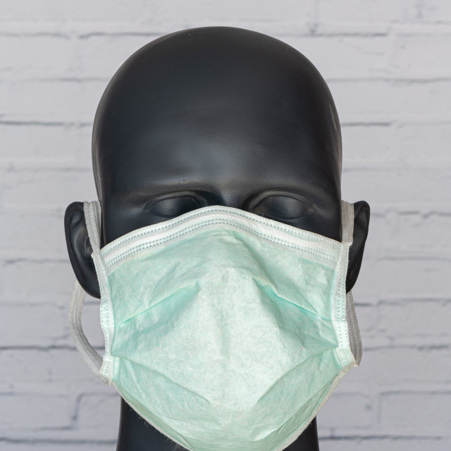 """""""Head image of mannequin wearing a surgical mask"""" stock image"""