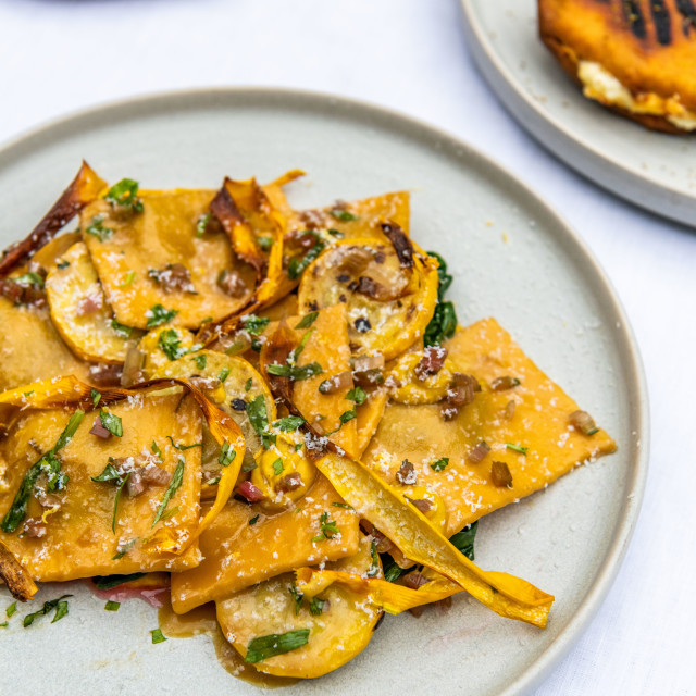 """""""Ravioli in foreground with two dishes behind"""" stock image"""