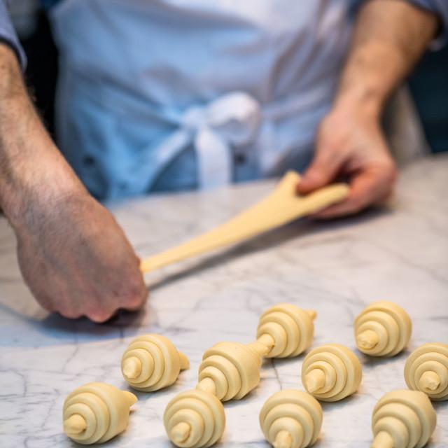 """""""Baker making croissants"""" stock image"""