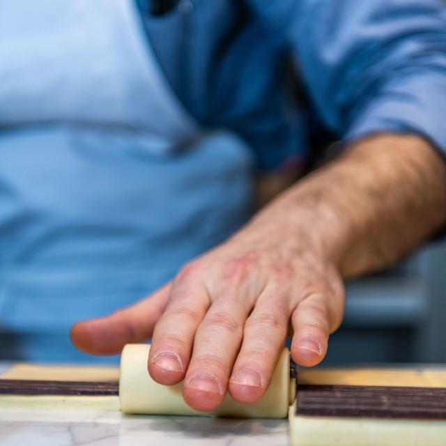 """Baker making chocolate croissants"" stock image"