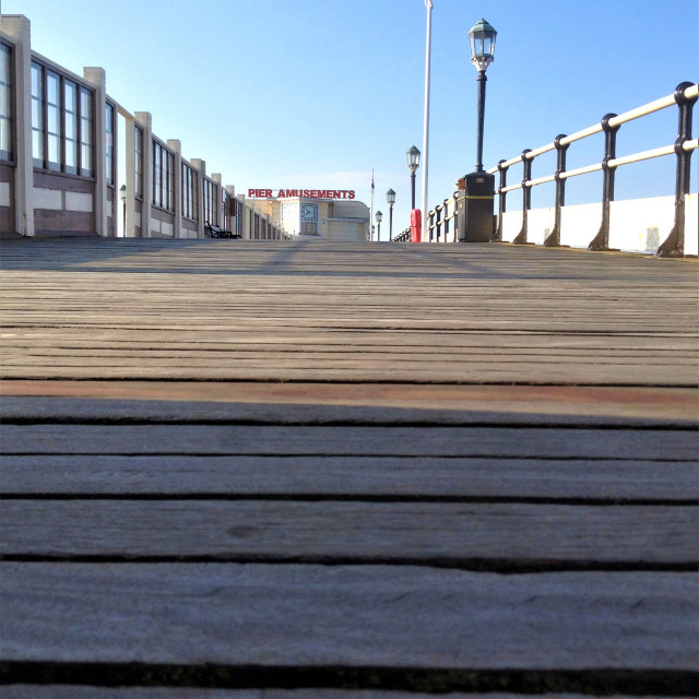 """Pier amusements from ground level"" stock image"