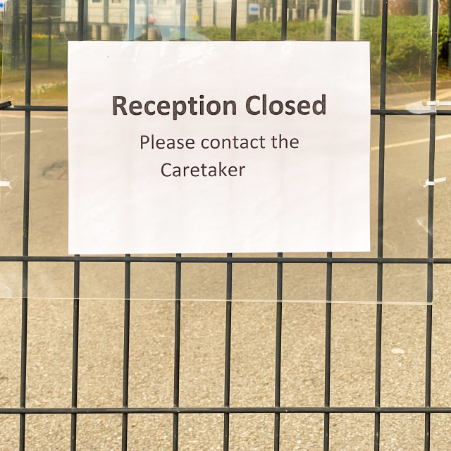 """""""""""Reception closed"""" sign on the gate of a school."""" stock image"""