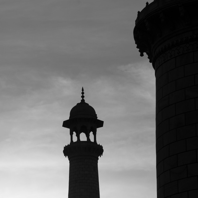 """Taj Mahal's minaret backlit by the early morning sun"" stock image"