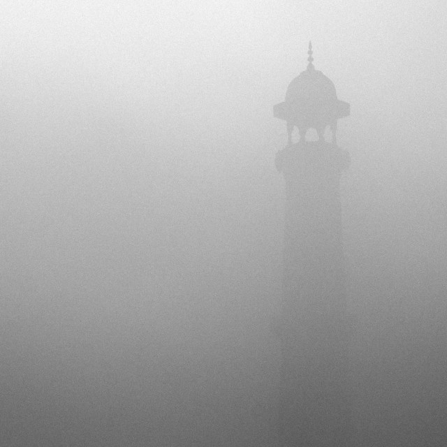 """Taj Mahal's minaret on a misty winter morning"" stock image"