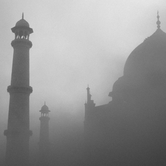 """Taj Mahal at sunrise on a misty day"" stock image"