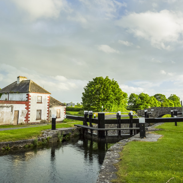 """""""Old red and white house beside a lock on the grand canal in Kildare on a..."""" stock image"""