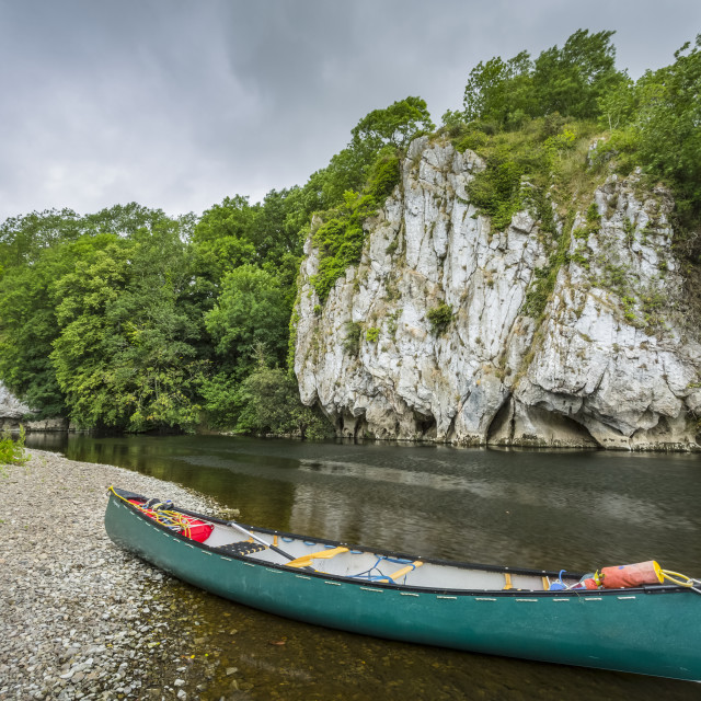 """""""A green canoe on the banks of the Blackwater river in Cork with white cliffs..."""" stock image"""