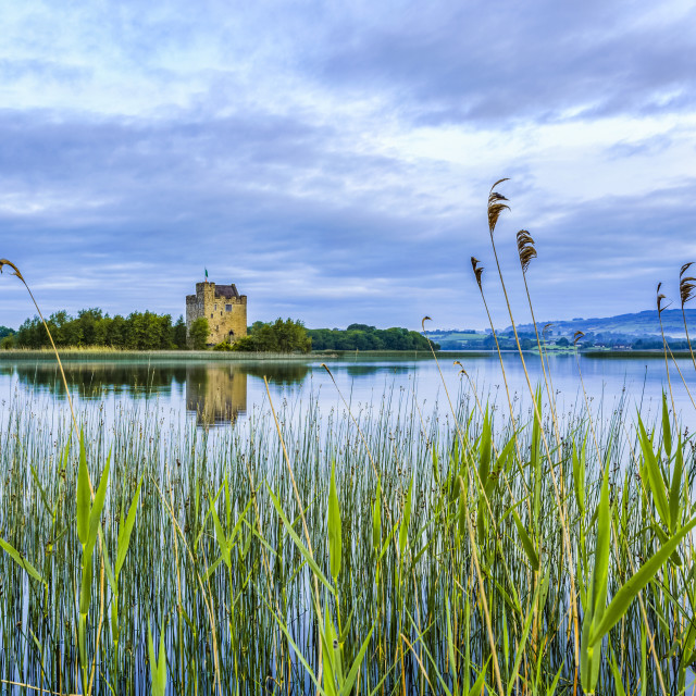 """""""Castlebawn castle on the shore of Lough Derg reflecting in the water on a..."""" stock image"""