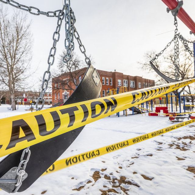 """""""A playground cordoned off with caution tape during the COVID-19 World..."""" stock image"""