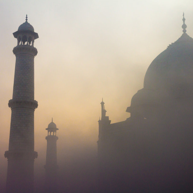 """Taj Mahal at sunrise on a misty January day"" stock image"