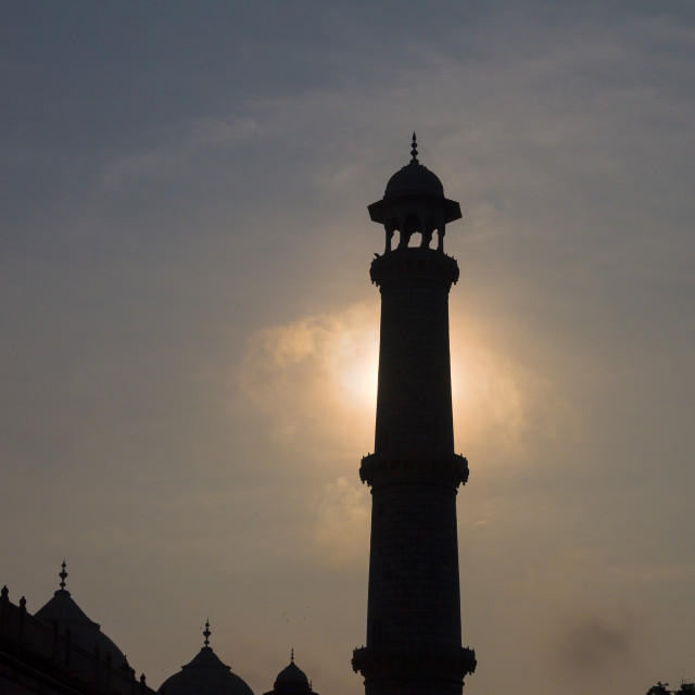 """Taj Mahal's minaret at sunrise"" stock image"