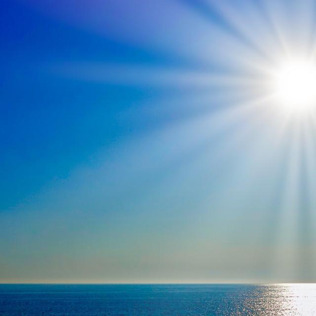 """Sunburst Over The Sea"" stock image"