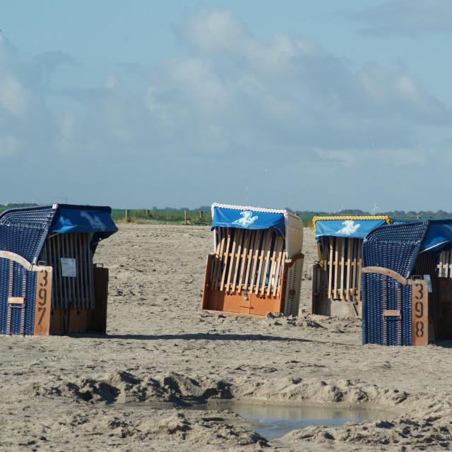 """beach chairs at empty beach / Strandkörbe am leeren Strand 2"" stock image"