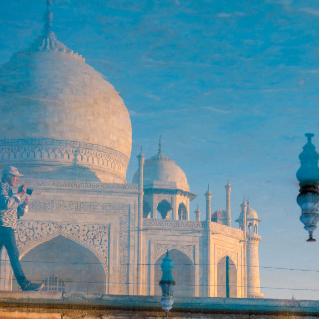 """Taj Mahal and a photographer reflected in the garden's pool"" stock image"