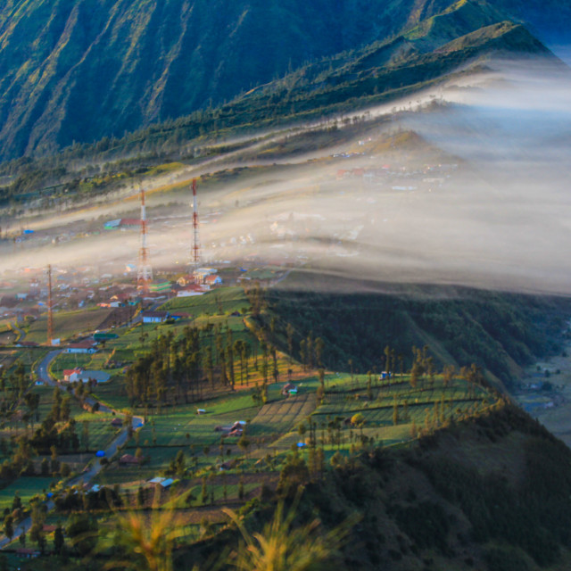 """""""Cemoro lawang at dawn covered with mist"""" stock image"""