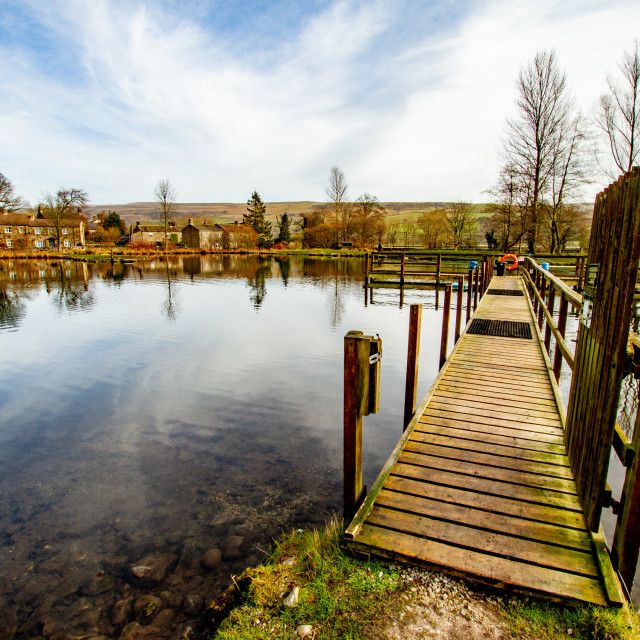 """Kilnsey Park Fly Fishing Lake, Kilnsey, Upper Wharfedale. Looking along fishing stands/walkway"" stock image"