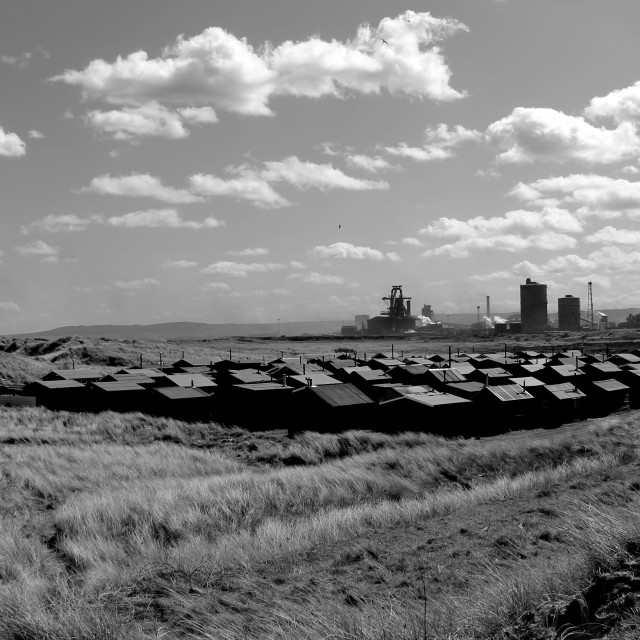 """Fisherman's huts and steel works at South Gare, Redcar."" stock image"