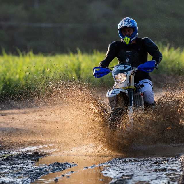 """""""Motorcycle riding through puddle"""" stock image"""