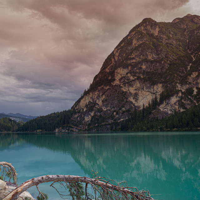 """""""The green waters of Lake Braies under a cloudy sky"""" stock image"""