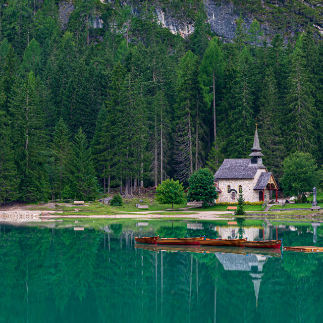 """""""A mountain church reflected in the water of Lake Braies"""" stock image"""