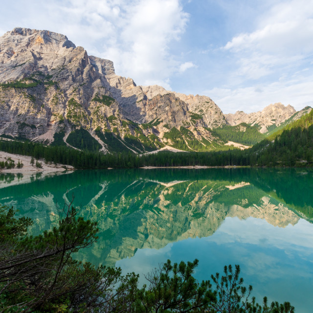 """""""View of Lake Braies under a blue sky with white clouds"""" stock image"""