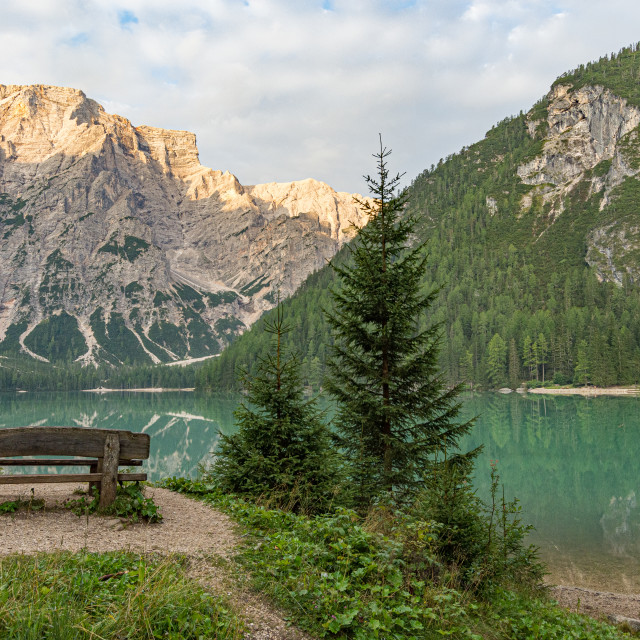 """""""Mountain landscape of Lake Braies with a bench, a church and in"""" stock image"""