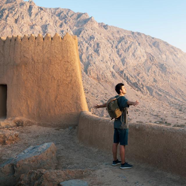 """""""Traveler exploring Dhayah Fort in north Ras Al Khaimah United Ar"""" stock image"""
